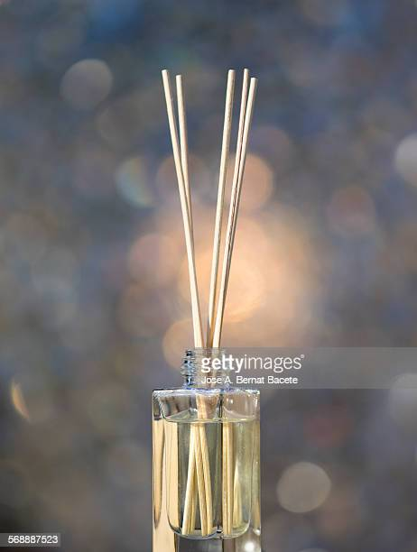 Freshener in a glass bottle with wooden sticks
