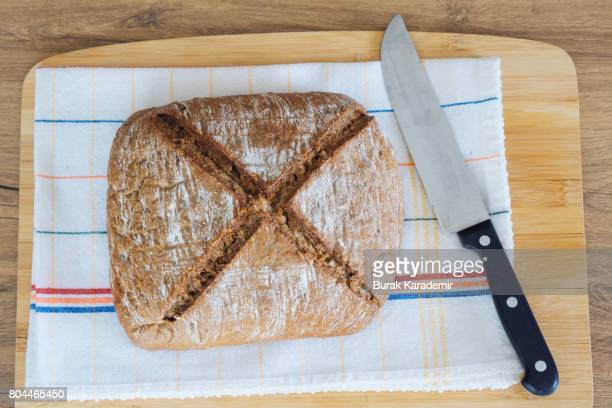 Freshly baked bread and knife