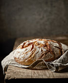 freshly baked bread on rustic wooden table