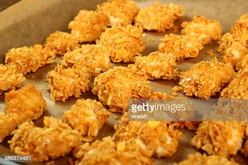 Freshly baked chicken fillet on baking sheet : Stock Photo