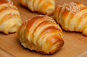 Freshly baked croissants on the table