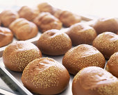 Freshly baked rolls with sesame seeds