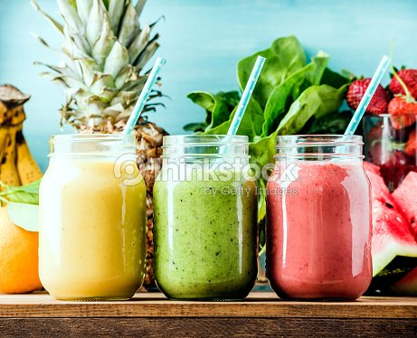 Freshly blended fruit smoothies of various colors and tastes : Stock Photo