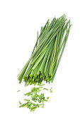 Freshly cut stands of chive against a white background