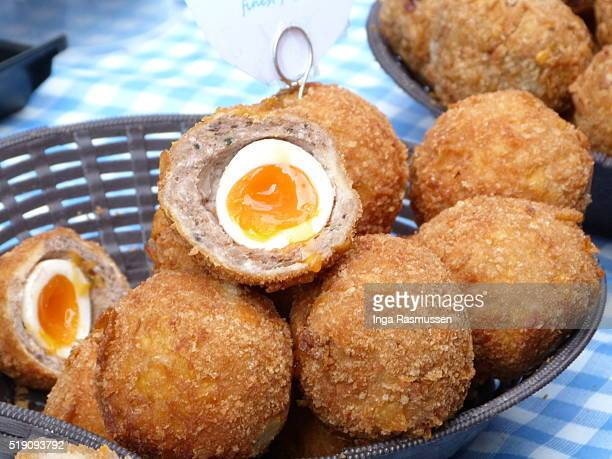 Freshly made scotch eggs on sale at London food market, England