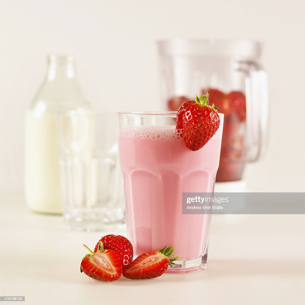 Freshly made strawberry milk shake and ingredients