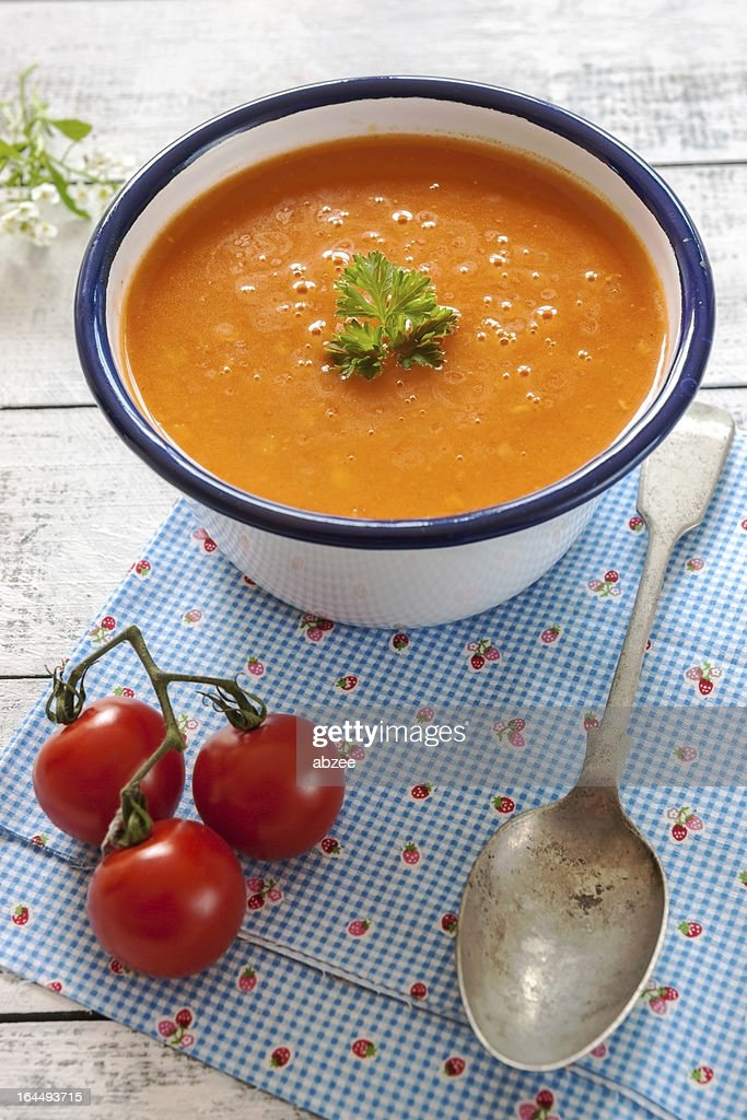 Freshly made tomato soup in blue and white bowl