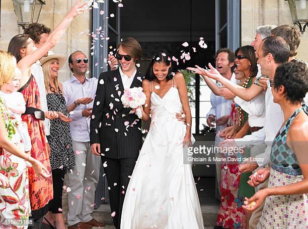 Freshly married couple leaving church
