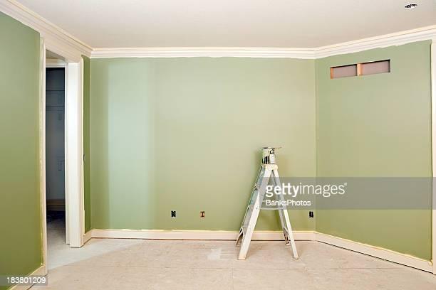 Un mur vert peint chambre à coucher
