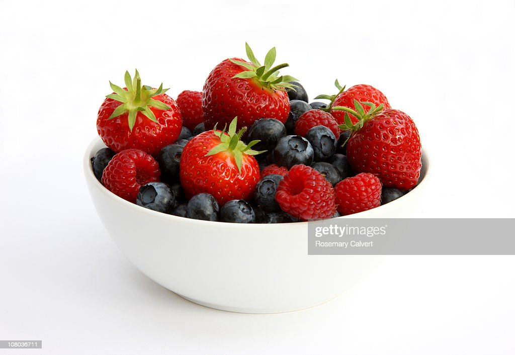 Freshly picked berries in white bowl.