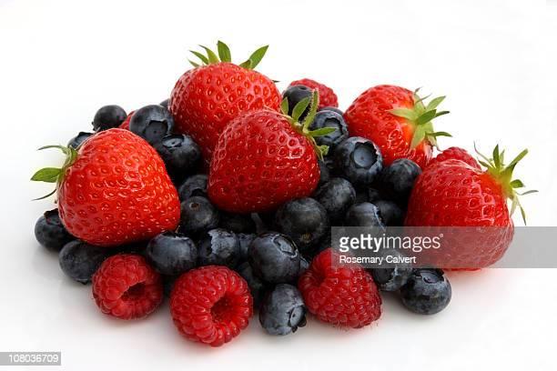 Freshly picked organic berries in pile.