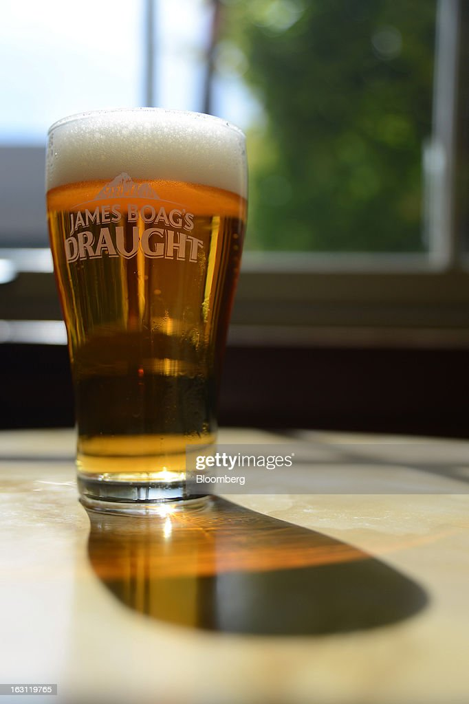 A freshly poured glass of Boag's Draught beer is arranged for a photograph at the Boag's brewery, operated by Kirin Holdings Co.'s Lion unit, in Launceston, Tasmania, Australia, on Monday, Feb. 25, 2013. Australia's Bureau of Statistics is scheduled to release fourth-quarter gross domestic product figures on March 6. Photographer: Carla Gottgens/Bloomberg via Getty Images