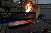 Freshly poured molten silver cools in a one kilogram mould during the semiautomated gold and silver bar manufacturing process at a precious metal...