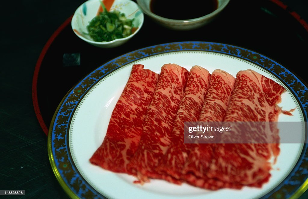 Freshly prepared kobe beef, a legendary Japanese delicacy, and one of the most expensive types of beef in the world- Nadaman restaurant, Tokyo, Japan : Stock Photo