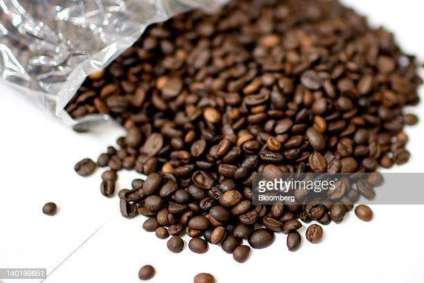 Freshly roasted coffee is displayed for a photograph at Nestle SA's Nescafe production facility in Dongguan Guangdong Province China on Tuesday Feb...