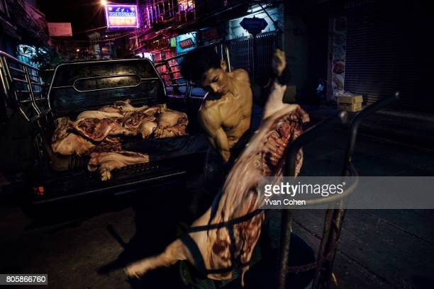 Freshly slaughtered pork being delivered to a market in the Yaowaraj district of Chinatown in Bangkok