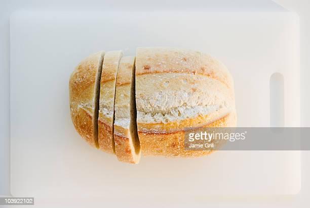 Freshly sliced bread on cutting board