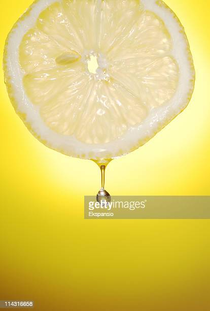 Freshly sliced lemon with a drop of water coming off it