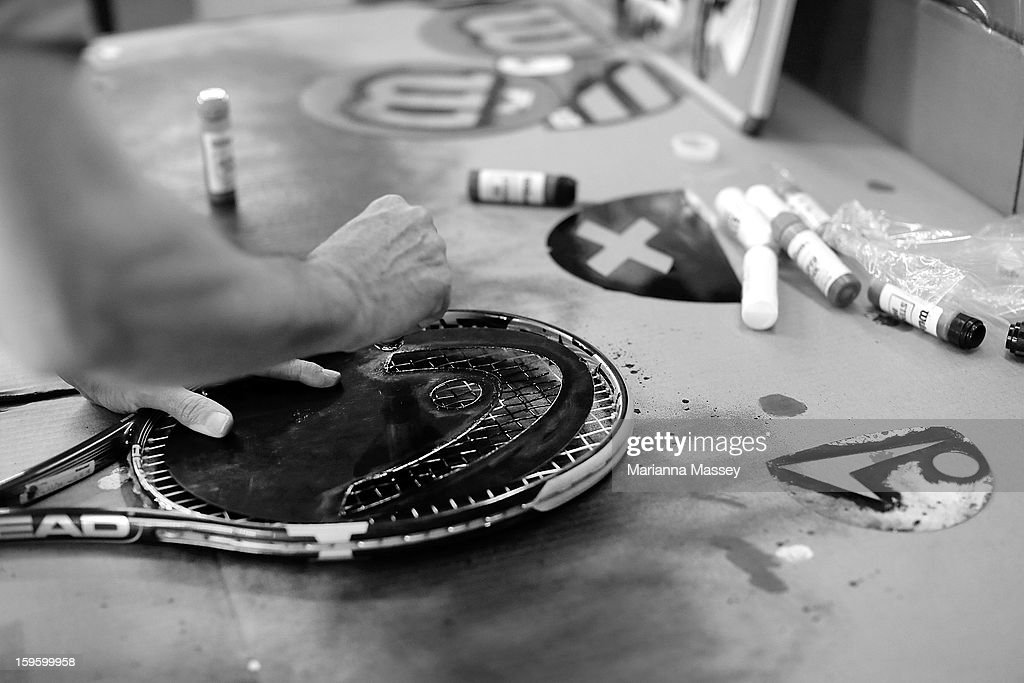 Freshly strung racquets are imprinted with sponsor logos in the stringers' hut at the 2013 Australian Open at Melbourne Park on January 17, 2013 in Melbourne, Australia.