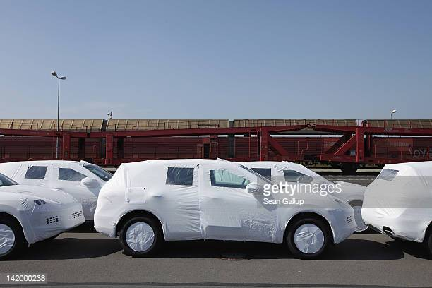 Freshlyassembled Porsche Cayenne cars destined for the USA stand at a rail depot before shipping at the Porsche factory on March 28 2012 in Leipzig...