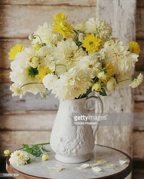 Freshly-cut flowers in a white vase.
