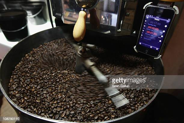 Freshlyroasted espresso coffee beans cool under an iPhone with a timer app attached to a refurbished 1918 Probat coffee bean roaster at Bonanza...