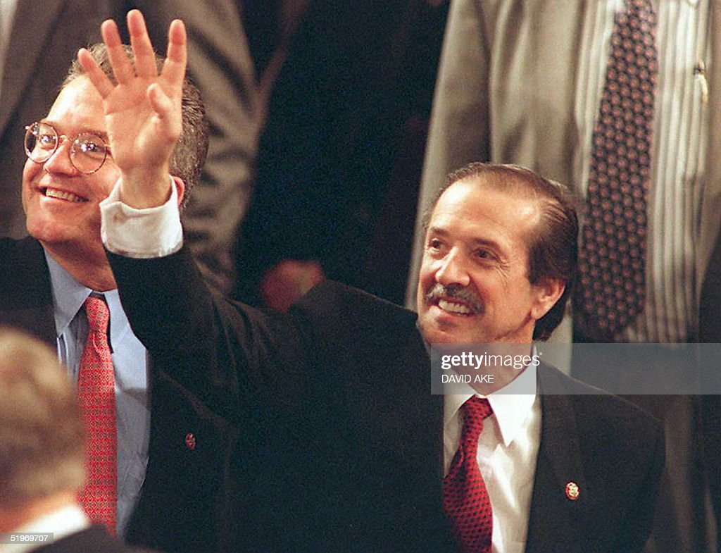 Freshman congressman Sonny Bono RCA waves to the gallery around the US House chamber during the first session of the 104th Congress in Washington DC...