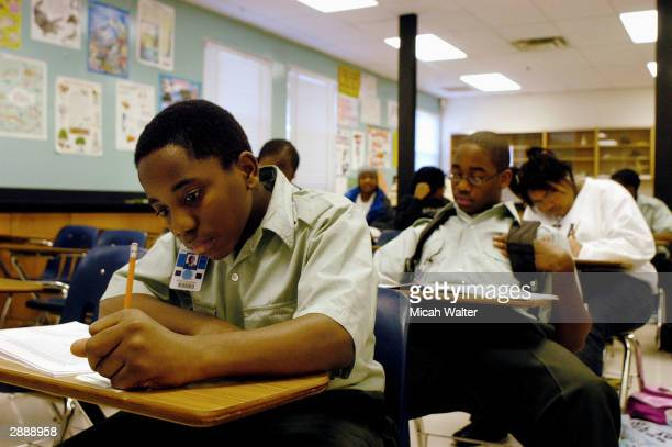 Freshman Donald Wiggins takes a final exam at the Forestville Military Academy January 21 2004 in Forestville Maryland Most of the students at...