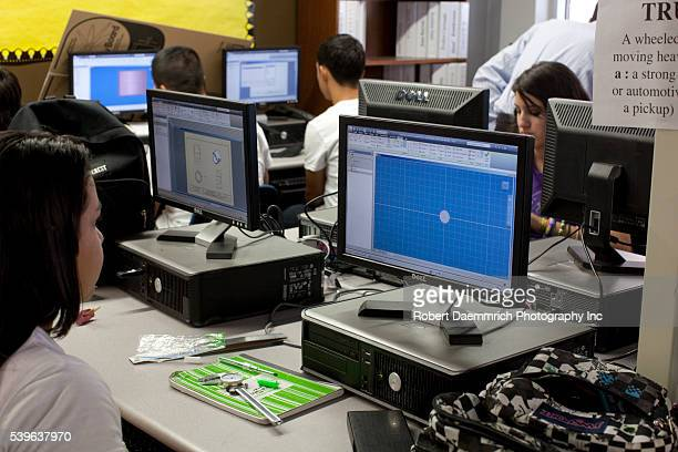 Freshman engineering students using computeraided design and precision micrometers to duplicate parts specifications for household items at the Math...