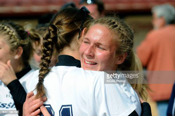 Freshman pitcher Jessica Rhoads of Messiah College embraces a teammate after their win over Coe College in the Division III Women's Softball...