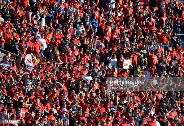 Fresno State Bulldogs fans react during the team's game against the USC Trojans during the Royal Purple Las Vegas Bowl at Sam Boyd Stadium on...