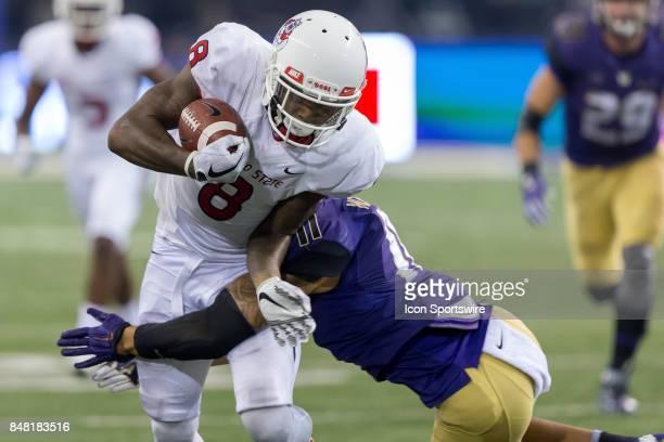 Fresno State Da'Mari Scott is hit by Washington Brandon McKinney during a college football game between the Washington Huskies and the Fresno State...