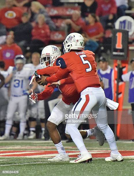 Fresno State quarterback Chason Virgil hands the ball off to during the Fresno State Bulldogs and the Air Force Falcons NCAA football game The...