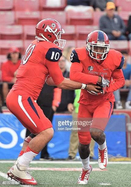 Fresno State quarterback Zach Kline hands the ball off to Fresno State running back Dontel James during the game between the Fresno State Bulldogs...