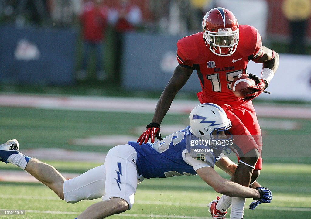 Fresno State's Davante Adams, right, picks up a few yards before being hit by Air Force's Gavin McHenry in the second half at Bulldog Stadium on Saturday, November 24, 2012, in Fresno, California.