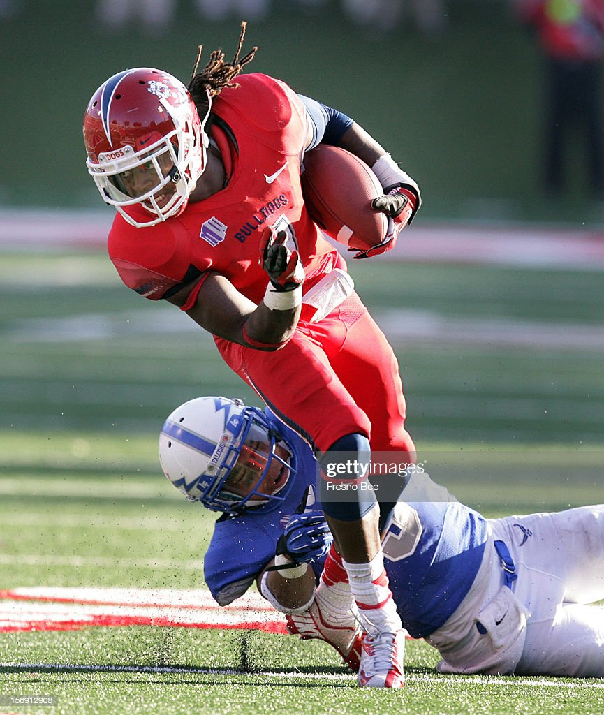 Fresno State's Isaiah Burse twists away from Air Force's Josh Harper for a few extra yards in the second half at Bulldog Stadium on Saturday, November 24, 2012, in Fresno, California.