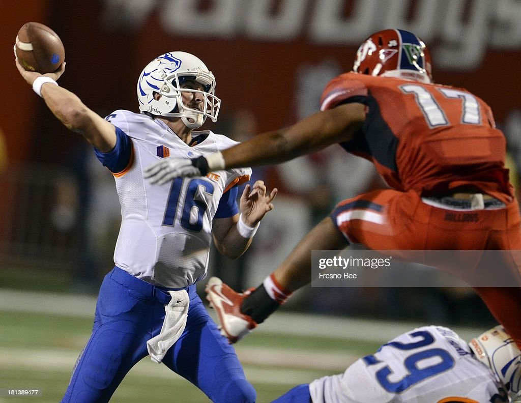 Fresno State's Kyrie Wilson rushes Boise State quarterback Joe Southwick in the first half at Bulldog Stadium in Fresno California on Friday...