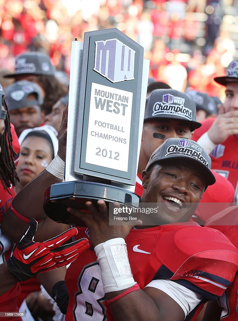 Fresno State's Robbie Rouse holds up the Mountain West Conference football championship trophy after the Bulldogs beat Air Force at Bulldog Stadium on Saturday, November 24, 2012, in Fresno, California. The Fresno State Bulldogs defeated trhe Air Force Falcons, 48-15.