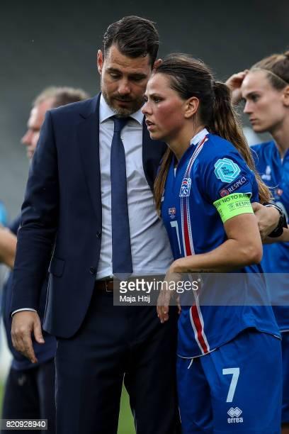 Freyr Alexandersson head coach of Iceland and Sara Bjork Gunnarsdottir of Iceland react after the UEFA Women's Euro 2017 Group C match between...