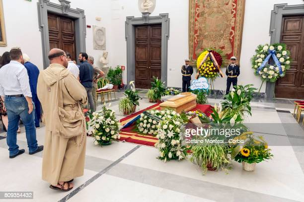 A friar in front the coffin of Italian actor Paolo Villaggio lying in repose at Rome's city hall on July 5 2017 in Rome Italy Paolo Villaggio died on...