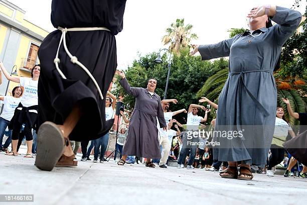 Friars nuns and youth perform a flash mob dance on the eve of Pope Francis' visit on September 21 2013 in Cagliari Italy Pope Francis heads to...
