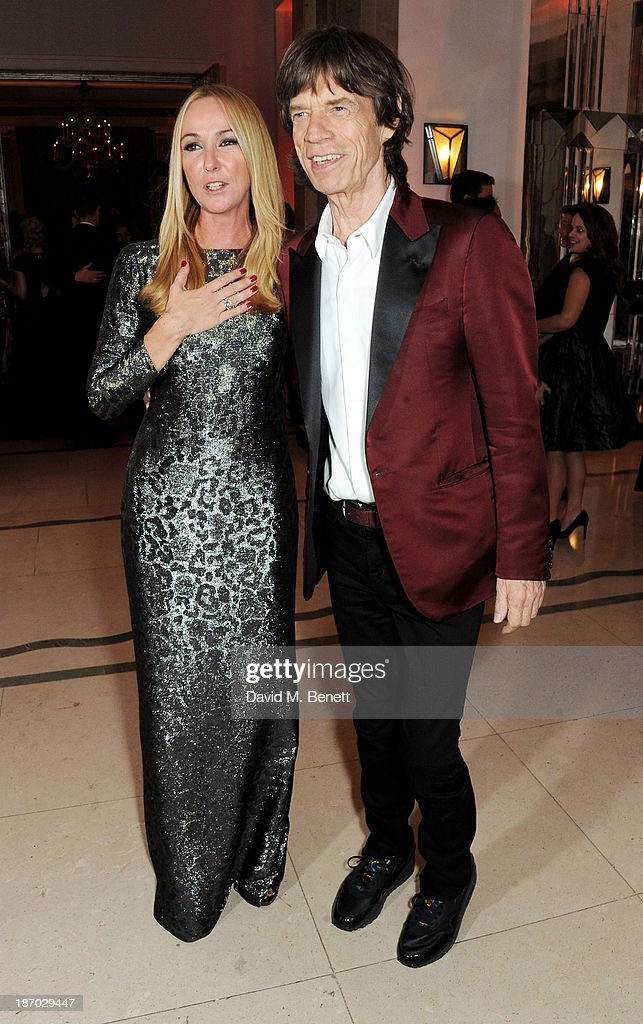 Frida Giannini (L) and Sir Mick Jagger attend the Harper's Bazaar Women of the Year awards at Claridge's Hotel on November 5, 2013 in London, England.