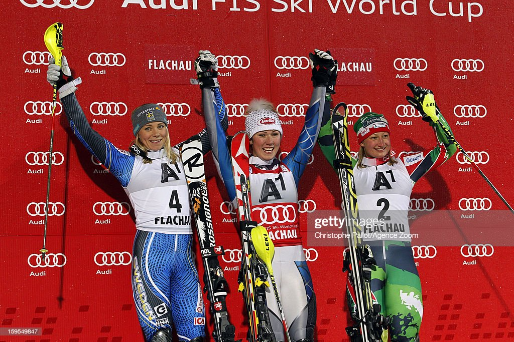Frida Hansdotter of Sweden takes 2nd place, Mikaela Shiffrin of the USA takes 1st place and <a gi-track='captionPersonalityLinkClicked' href=/galleries/search?phrase=Tanja+Poutiainen&family=editorial&specificpeople=215271 ng-click='$event.stopPropagation()'>Tanja Poutiainen</a> of Finland takes 3rd place during the Audi FIS Alpine Ski World Cup Women's Slalom on January 15, 2013 in Flachau, Austria.