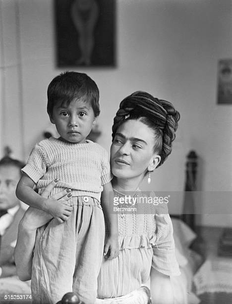 Frida Kahlo Mexican painter and wife of Diego Rivera is shown here with child