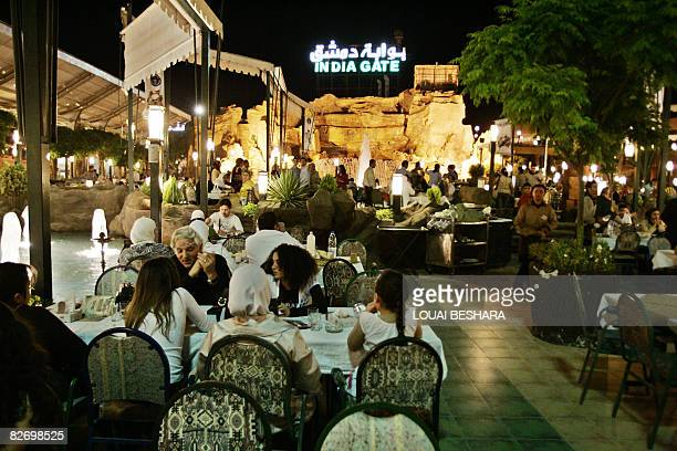 Friday night diners gather in the Indian themed outdoor section of the Damascus Gate the world's largest restaurant in Damascus on June 13 2008 At...