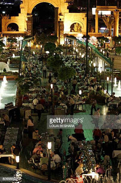 Friday night diners gather in the outdoor area of the Damascus Gate the world's largest restaurant in Damascus on June 13 2008 At 54000 sqm with a...