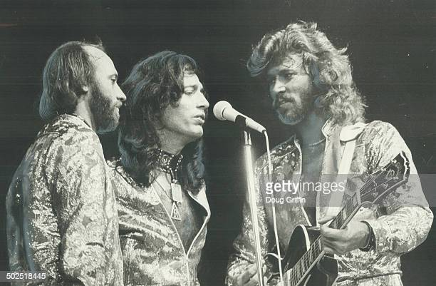 Friday night fever The Bee Gees from left Maurice Robin and Barry Gibb started with a happy boom and gave a capacity crowd of 18500 at the Gardens a...