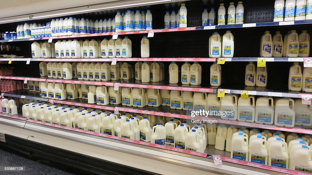 Fridges stocked with milk are seen in a Coles supermarket on May 24, 2016 in Sydney, Australia. Coles shelves are low on branded milk stock as consumers purchase more expensive brands in support of local farmers. Australians are rallying around it's dairy farmers by opting to purchase branded milk rather than the cheaper store brands after the country's largest dairy company Murray Goulburn last month cut the price it pays suppliers by 15%.