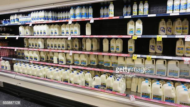 Fridges stocked with milk are seen in a Coles supermarket on May 24 2016 in Sydney Australia Coles shelves are low on branded milk stock as consumers...