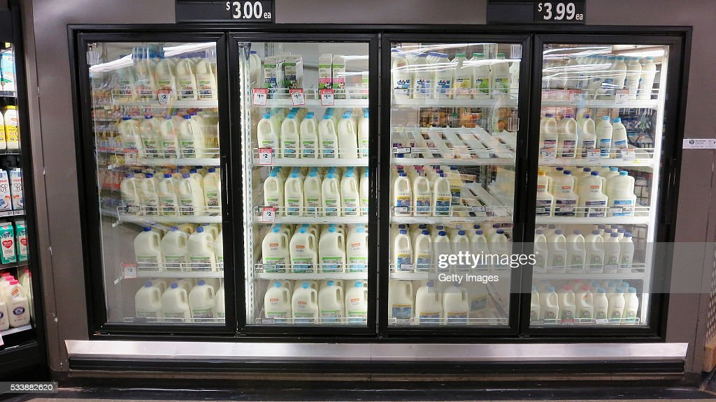 Fridges stocked with milk are seen in a Woolworths supermarket on May 24, 2016 in Sydney, Australia. Australians are rallying around it's dairy farmers by opting to purchase branded milk rather than the cheaper store brands after the country's largest dairy company Murray Goulburn last month cut the price it pays suppliers by 15%.